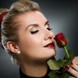 Charming lady with red rose — Stock Photo #2085699