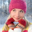 Beautiful young blond in winter forest — Stockfoto
