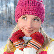 Beautiful young blond in winter forest — Foto Stock