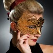 Lovely young woman with carnival mask — Stock Photo #2085826