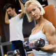 Strong woman lifting heavy dumbbells — Stok fotoğraf