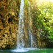 Sunrise over waterfall in wild forest — Stock Photo #2086140