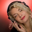 Blond woman listening to the music — Stock Photo #2086237