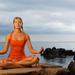 Beautiful woman doing yoga exercise — Stock Photo