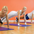 Group of completing push ups - Stock Photo