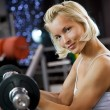 Strong woman lifting heavy weights — Stock Photo #2086494
