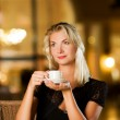 Beautiful young woman drinking coffee — Stock Photo #2086518