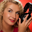 Stock Photo: Blond woman listening to the music