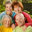 Senior couple with their family — Stock Photo