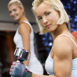 Strong woman lifting heavy dumbbells - Stock Photo