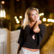 Woman relaxing outdoors at night — Stock Photo