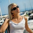 Pretty young lady near the yacht club — Stock Photo