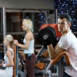 Group of working out in a gym - Stock Photo