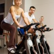 Doing exercise on a bike — Stock Photo #2086910