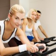Doing exercise on a bike — Stock Photo