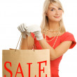 Beautiful young woman with a bags — Stock Photo