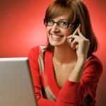 Beautiful woman working on her laptop — Stock Photo