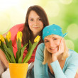Beautiful teenager with spring flowers — Stock Photo #2087111