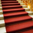Royalty-Free Stock Photo: Stairs covered with red carpet