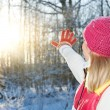 图库照片: Young womwaving goodbye to winter