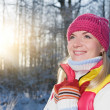 Beautiful young woman in winter forest — Stockfoto
