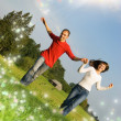 Young couple running on a meadow — Stockfoto