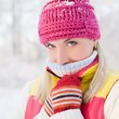 Frozen woman in winter clothing — Stock Photo