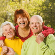 Senior couple with their daughter - Stock Photo