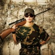Woman soldier with a sniper rifle — Stock Photo
