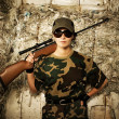 Woman soldier with a sniper rifle - Stock Photo