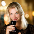 Beautiful young woman drinking red wine — Stock Photo #2087513
