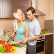 Young couple making vegetable salad — Stock Photo #2087607