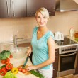 Stock Photo: Beautiful woman making salad