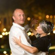 Middle-aged couple dancing waltz — Stock Photo