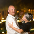 Middle-aged couple dancing waltz - Stock Photo