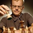 Stock Photo: Chess master making smart move