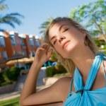 Beautiful young woman relaxing outdoors — Stock Photo