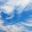 Blue sky with fluffy clouds — Stock Photo
