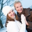 Two beautiful women in winter clothing — Stock Photo