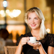Beautiful young woman drinking coffee — Stock Photo #2087847