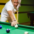 Stock Photo: Man playing billiards