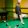 Beautiful blond woman playing billiards — Stock Photo #2087943