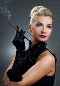 Charming lady smoking cigarette — Stock Photo