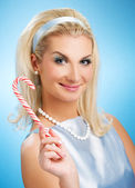 Beautiful young woman with lollypop — Stock Photo