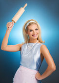 Happy housewife with rolling pin — Stock Photo