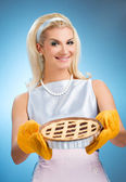 Beautiful woman holding hot italian pie — Foto de Stock