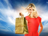 Beautiful young woman with a bag — Stock Photo