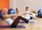 Group of doing fitness exercise — Stock Photo