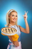Beautiful woman holding hot italian pie — Stock Photo