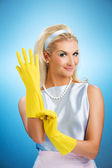 Happy housewife with rubber gloves — Stock Photo